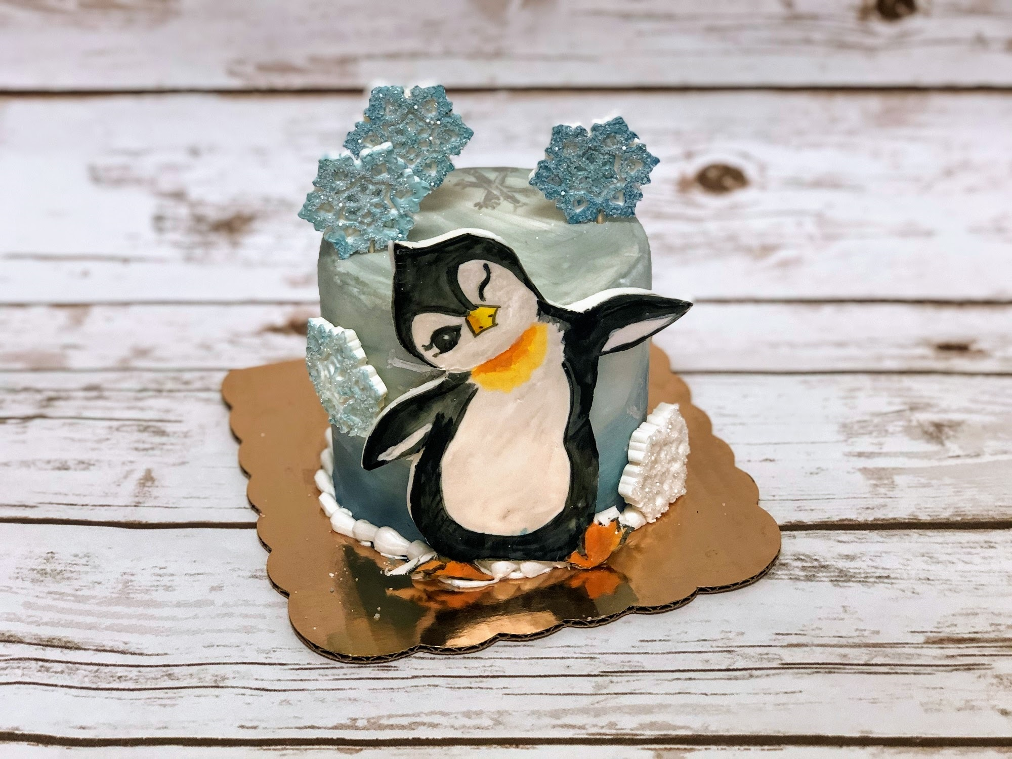Poppy Painted Penguin Cake